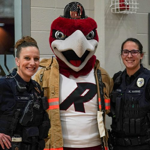 Alumnae and officers Lindsey Michels and Kaylee Haring with Rally the Red Hawk