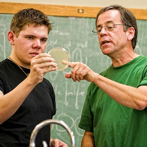 Sam Sondalle '11 as a student with Associate Professor of Biology Mark Kainz