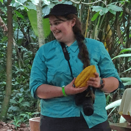 Student Elena Byrd with a cacao bean in Costa Rica