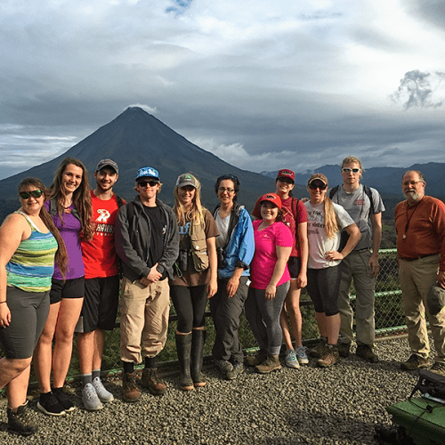 A group of Ripon College students in Costa Rica with the Arenal Volcano in the background
