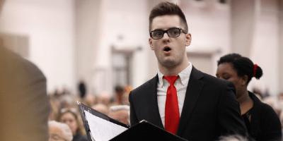 Tommy Poullette '21 singing during a concert.