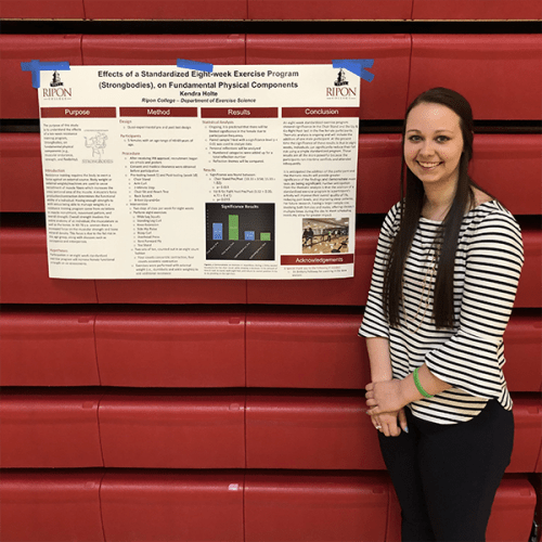 Kendra Holte' with a presentation poster