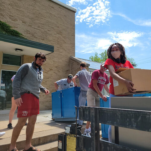 Faculty, staff and students unload donations of science equipment